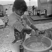 American Circus-Theatre / Daiane (C) Patricia and Natali (R) wash clothes in the morning, in Colonia Itapebí, Salto, northwestern Uruguay, on August 28, 1996.