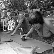Oriental Circus / Bettina and don sánchez prepare a board for painting, in the Viaducto, Montevideo on December 14, 1996.